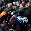 Disabled supporters attend a football match. Credit: PA